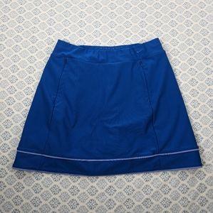 Nike Golf blue skirt zippered pockets Sz medium